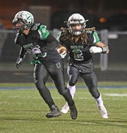 Clear Fork's Trevon Trammell runs the football during the Colts' playoff run last season. Clear Fork is looking to add turf to their football field for the 2019 fall season