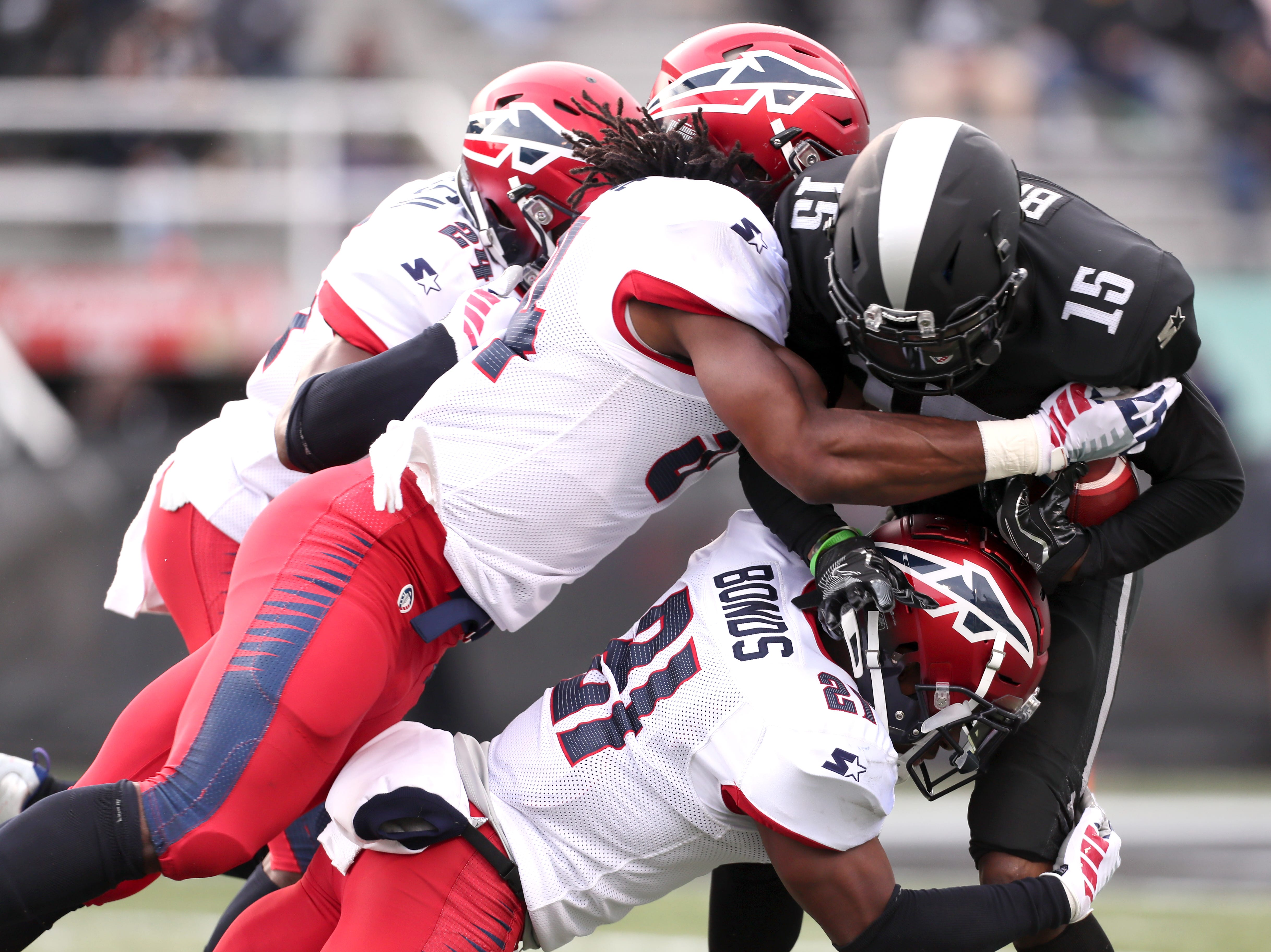 Birmingham Iron wide receiver Quan Bray is gang-tackled by Memphis Express defenders, including Charles James II, from top, Quentin Gause and Terrell Bonds during their game at Legion Field in Birmingham, Ala. on Sunday, Feb. 10, 2019.