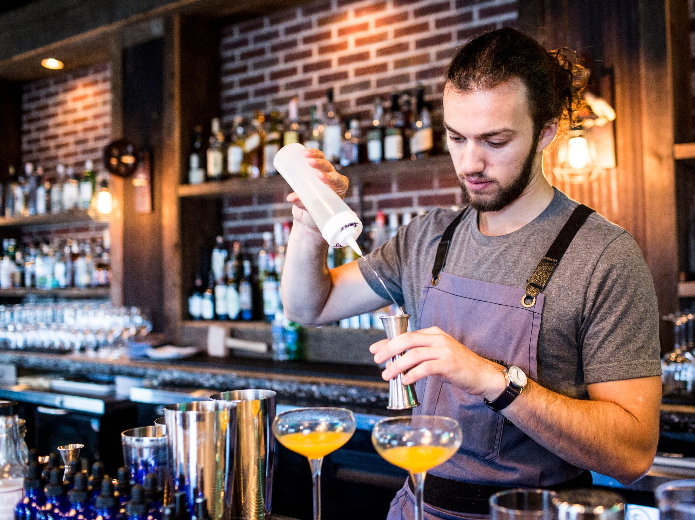 February 10, 2019 - Robert Schutt creates a drink during Sunday brunch at PO Press Public House & Provisions in Collierville. PO Press Public House & Provisions is located at 148 N Main St. in Collierville.