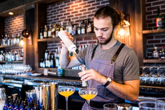 Robert Schutt creates a drink during Sunday brunch at P.O. Press Public House & Provisions in Collierville.