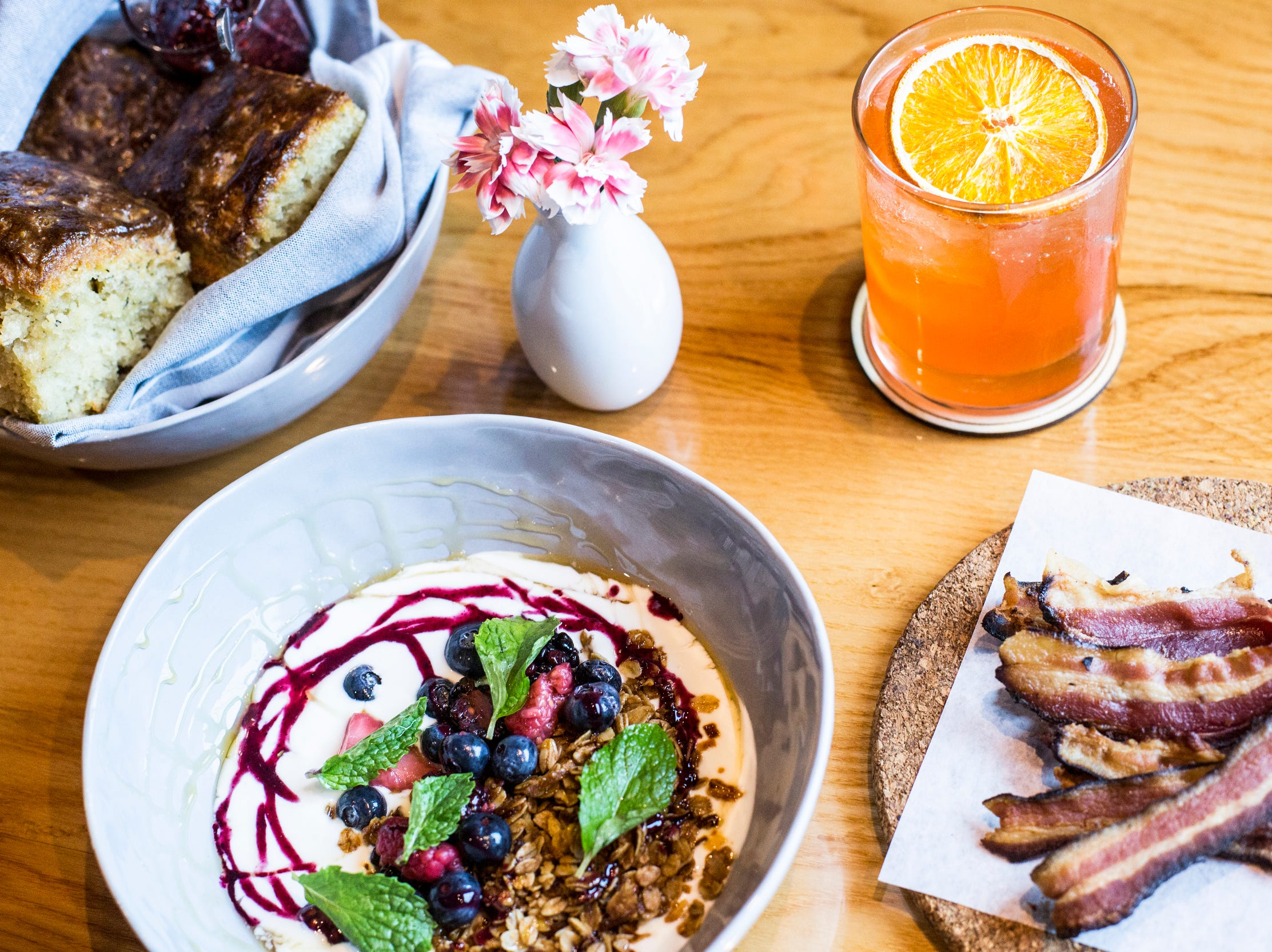 February 10, 2019 - From left, a biscuit basket, yogurt, rose spritz, and a serving of house bacon are seen during Sunday brunch at PO Press Public House & Provisions in Collierville. PO Press Public House & Provisions is located at 148 N Main St. in Collierville.