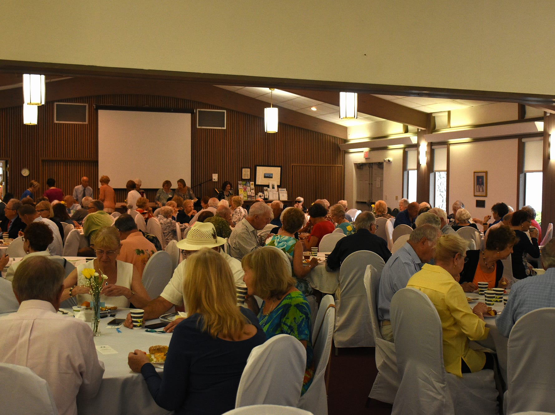Congregants fill the fellowship hall at the brunch following the dedication. United Church of Marco Island held a ceremony Sunday dedicating their newly erected steeple, which was damaged during Hurricane Irma.