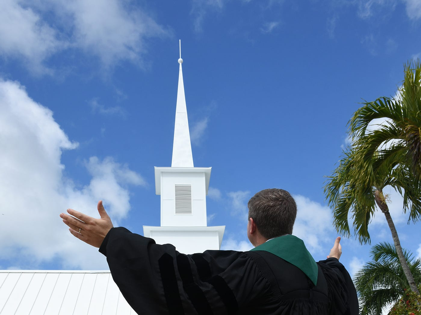 Pastor Mark Williams with the new steeple. United Church of Marco Island held a ceremony Sunday dedicating their newly erected steeple, which was damaged during Hurricane Irma.