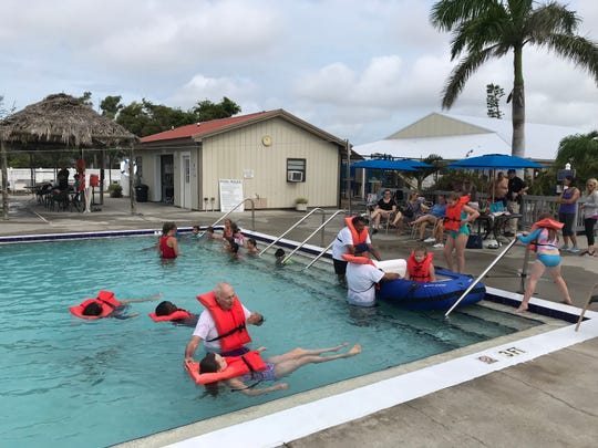 Coast Guard Auxiliary members put youngsters through part of a boating safety course at the Y pool.