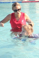 Aquatics program director Morgan Joseph works with a young swimmer at the Marco Y.