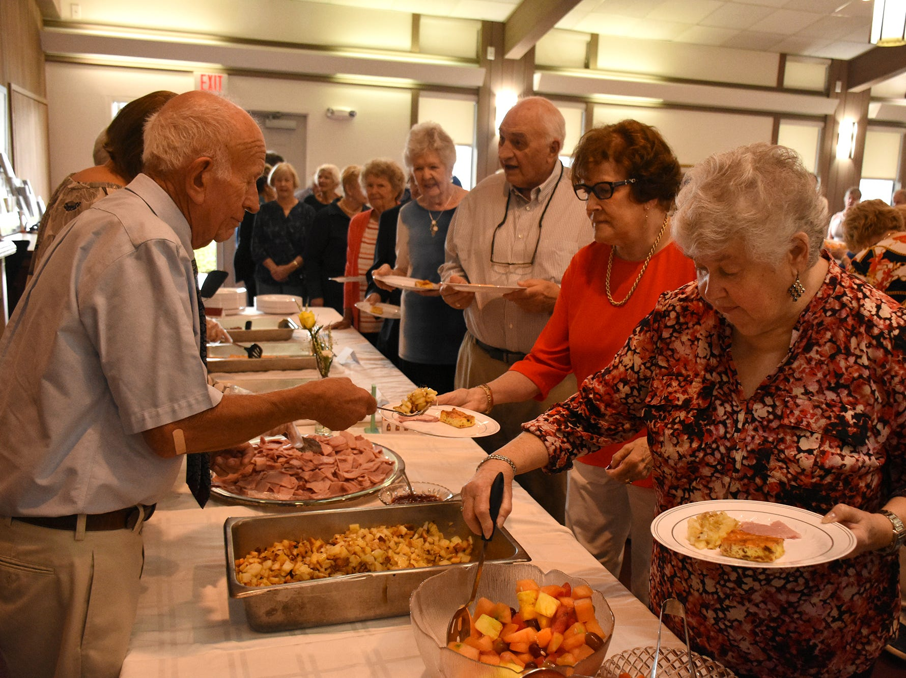 Paul O'Neill serves breakfast as Yvonne Hall gets some fruit at the brunch following the dedication. United Church of Marco Island held a ceremony Sunday dedicating their newly erected steeple, which was damaged during Hurricane Irma.United Church of Marco Island held a ceremony Sunday dedicating their newly erected steeple, which was damaged during Hurricane Irma.
