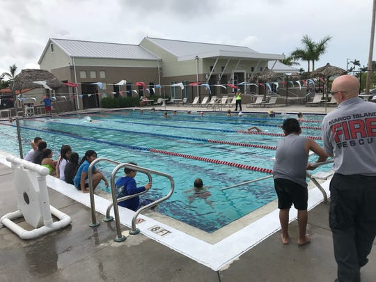 Members of the MIFD instruct young swimmers on rescue techniques.