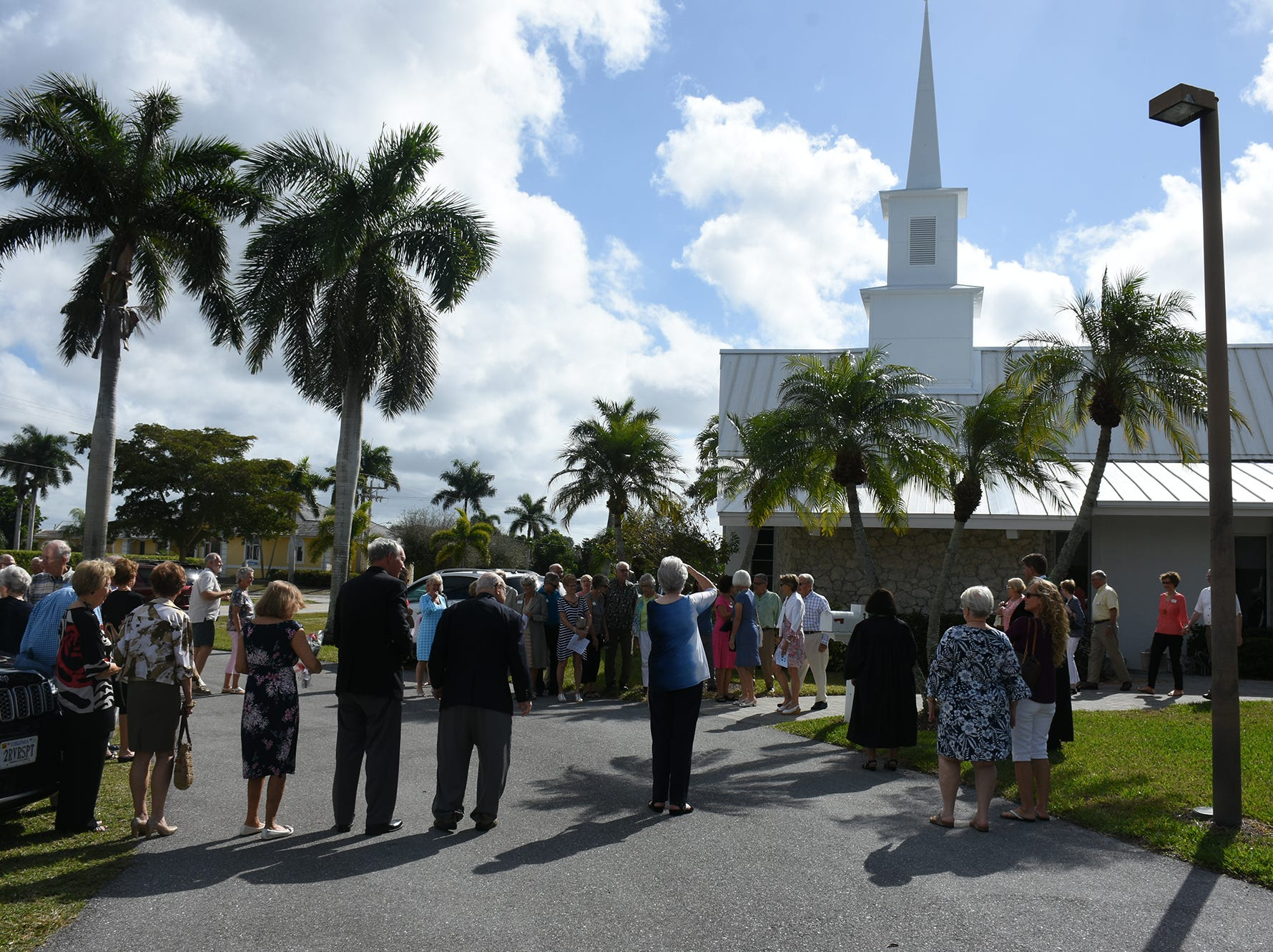 Parishioners gather outside for the dedication. United Church of Marco Island held a ceremony Sunday dedicating their newly erected steeple, which was damaged during Hurricane Irma.