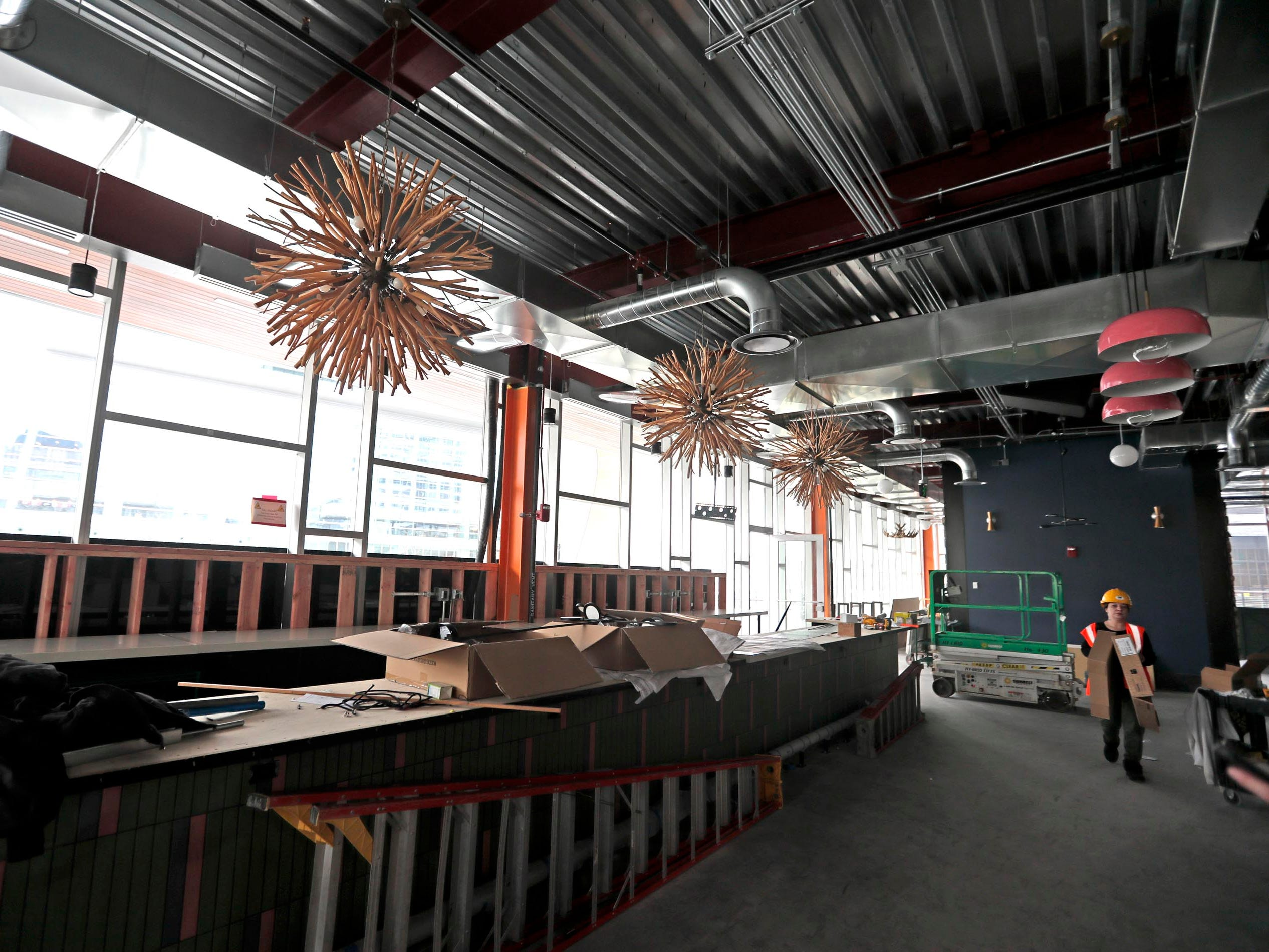 "Crews work Monday at Punch Bowl Social, which will bring its ""experiences within experiences,"" including craft cocktails, scratch kitchen and games, to the Fiserv Forum entertainment block with a grand opening March 9."