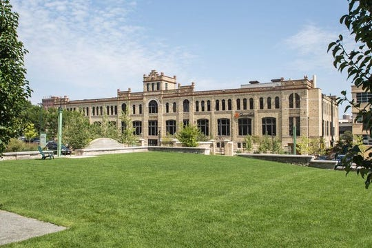 CH2M/Jacobs Group, an engineering firm, is moving to the Bottlehouse buildings at downtown Milwaukee's Schlitz Park business park.