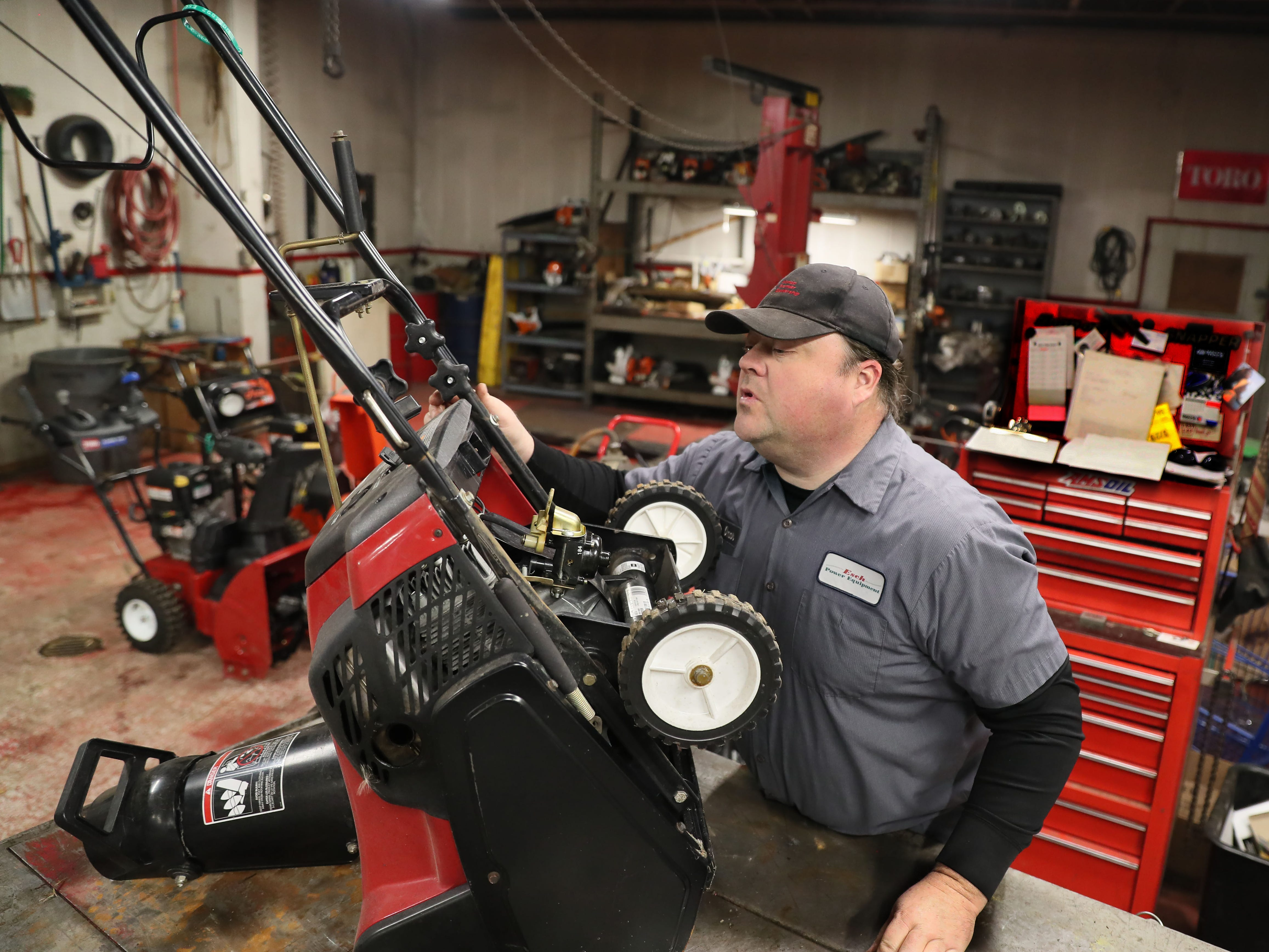 February 11, 2019 Mike Dolski, lead technician at Esch Power Equipment in Oak Creek, works on a customer's snowblower that was not working properly.