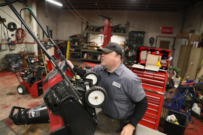 February 11, 2019 Mike Dolski, lead technician at Esch Power Equipment in Oak Creek, works on a customer's snowblower that was not working properly.