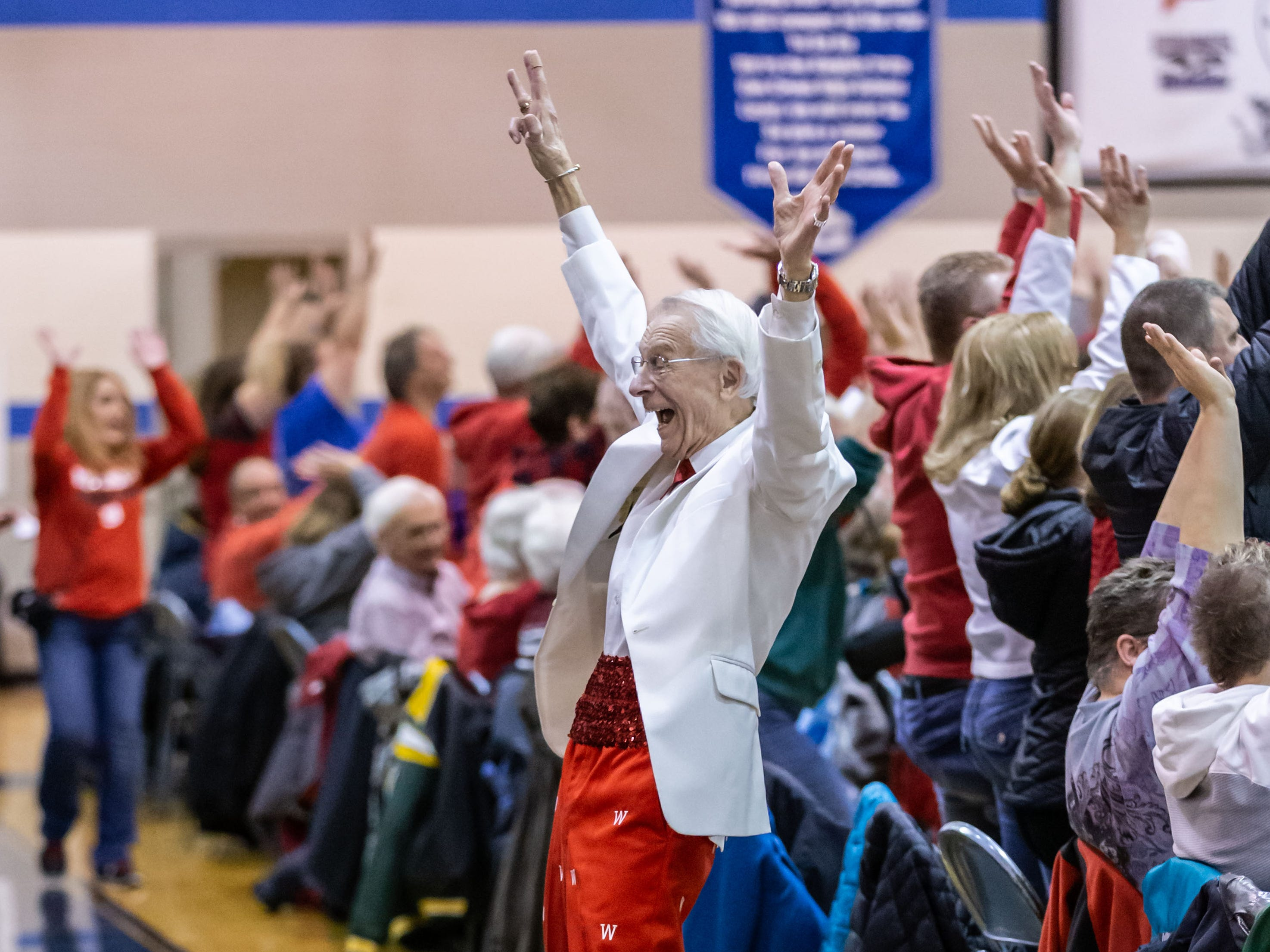 """University of Wisconsin-Madison Varsity Band Director Michael Leckrone interacts with the crowd during the band's 23rd """"Show and Revue"""" at Oak Creek High School on Sunday, Feb. 10, 2019."""