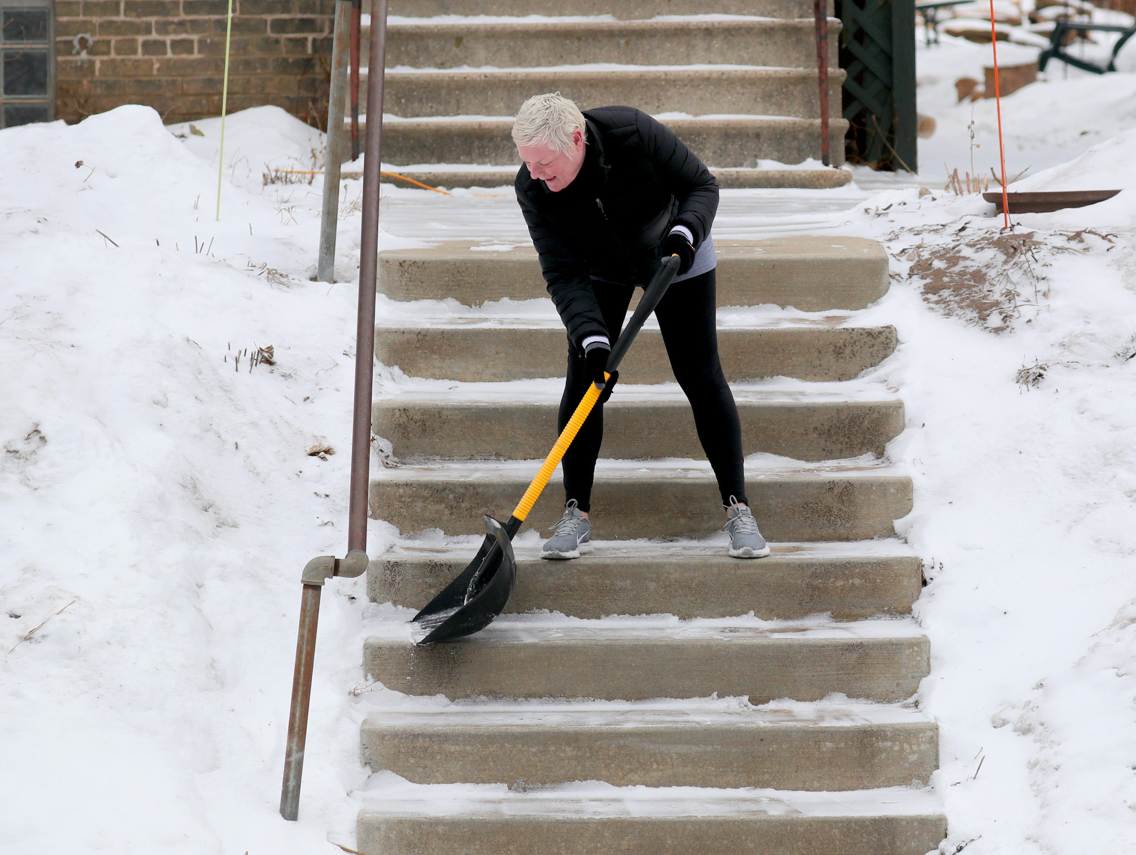 Karen Nastulski shovels a fresh coat of snow on steps in front of her home on South Logan Avenue in Bay View on Monday, Feb. 11, 2019. The National Weather Service has issued a winter storm warning for central, northern and northeastern Wisconsin from 9 p.m. Monday until 12 a.m. Wednesday. Photo by Mike De Sisti / Milwaukee Journal Sentinel