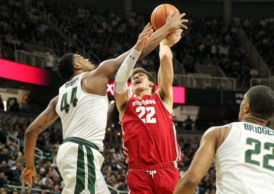 Wisconsin Badgers forward Ethan Happ has his shot blocked by Michigan State's Nick Ward on Jan 26, 2018. Ward and other Spartans defenders will attempt to harass Happ and UW in the paint when the teams meet Tuesday.