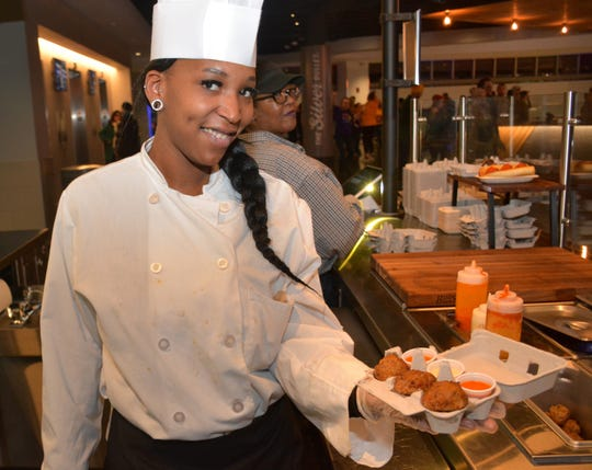 Princess Cosey displays Calderone Club meatballs at a new stand on the Fiserv Forum upper concourse.