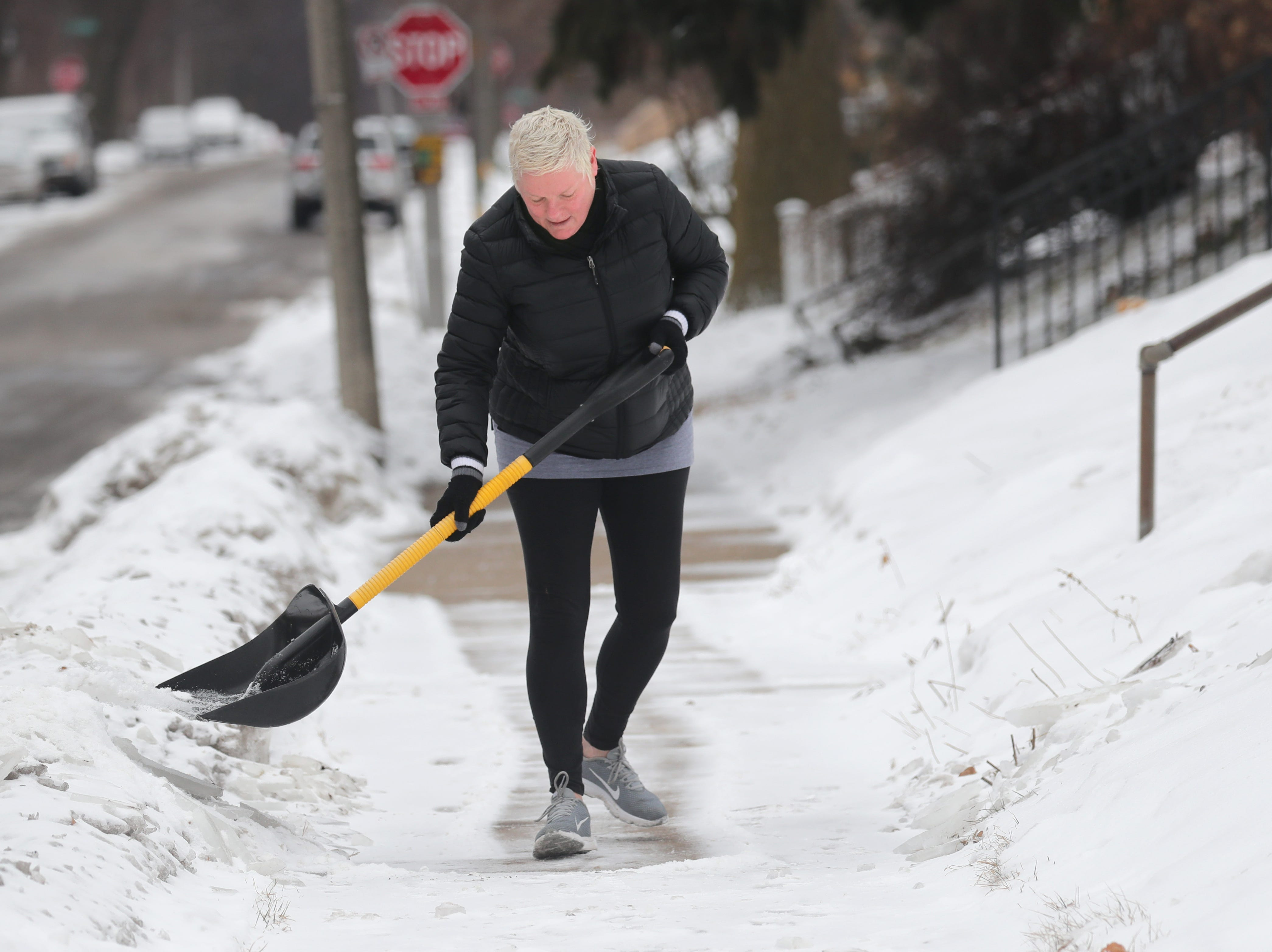Karen Nastulski shovels a fresh coat of snow in front of her home on South Logan Avenue in Bay View on Monday, Feb. 11, 2019. The National Weather Service has issued a winter storm warning for central, northern and northeastern Wisconsin from 9 p.m. Monday until 12 a.m. Wednesday. Photo by Mike De Sisti / Milwaukee Journal Sentinel