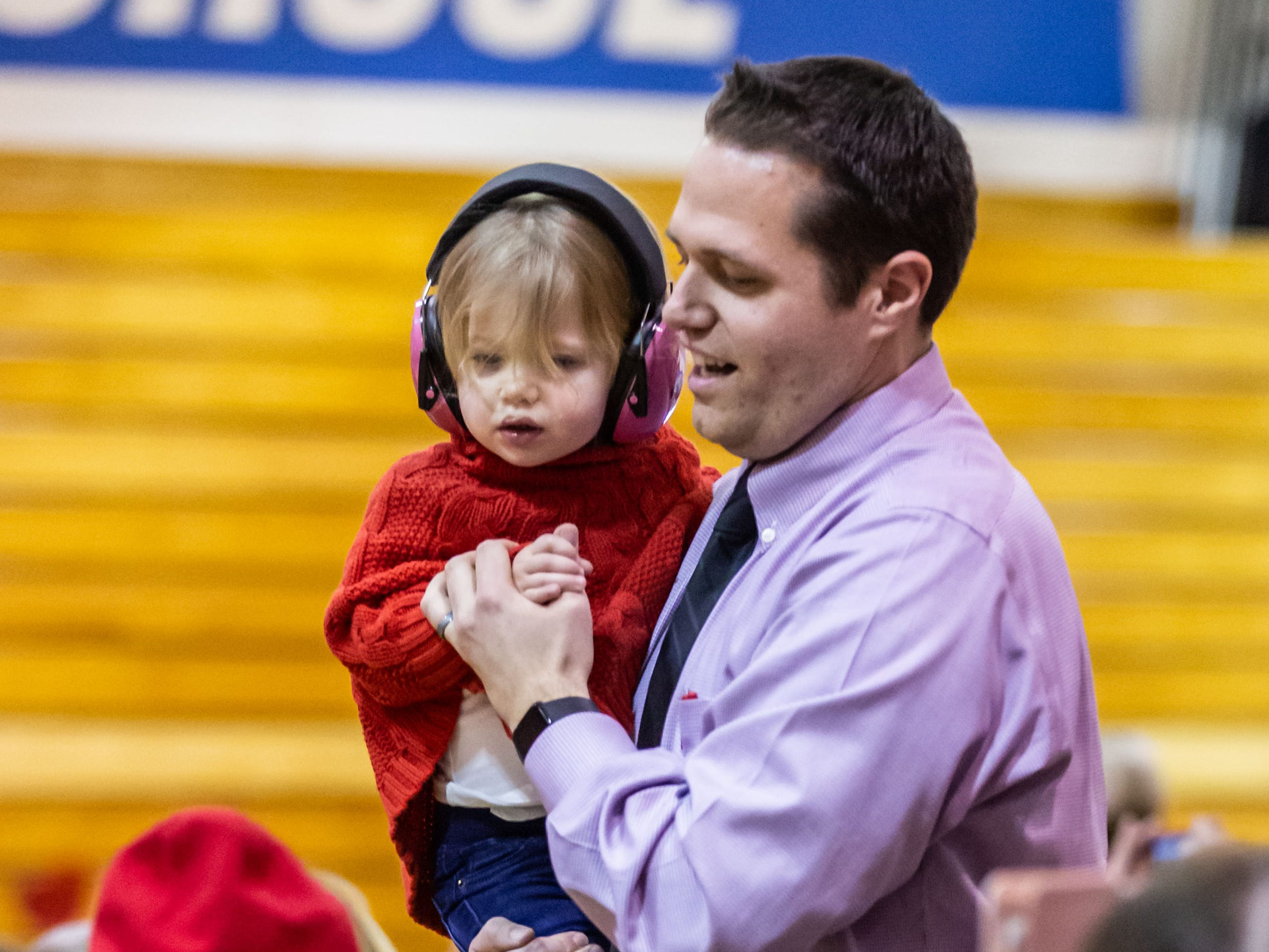 """Oak Creek High School Band Director Guy Gregg dances with his 2-year-old daughter Tessa during the University of Wisconsin-Madison Varsity Band's 23rd """"Show and Revue"""" at the school on Sunday, Feb. 10, 2019."""