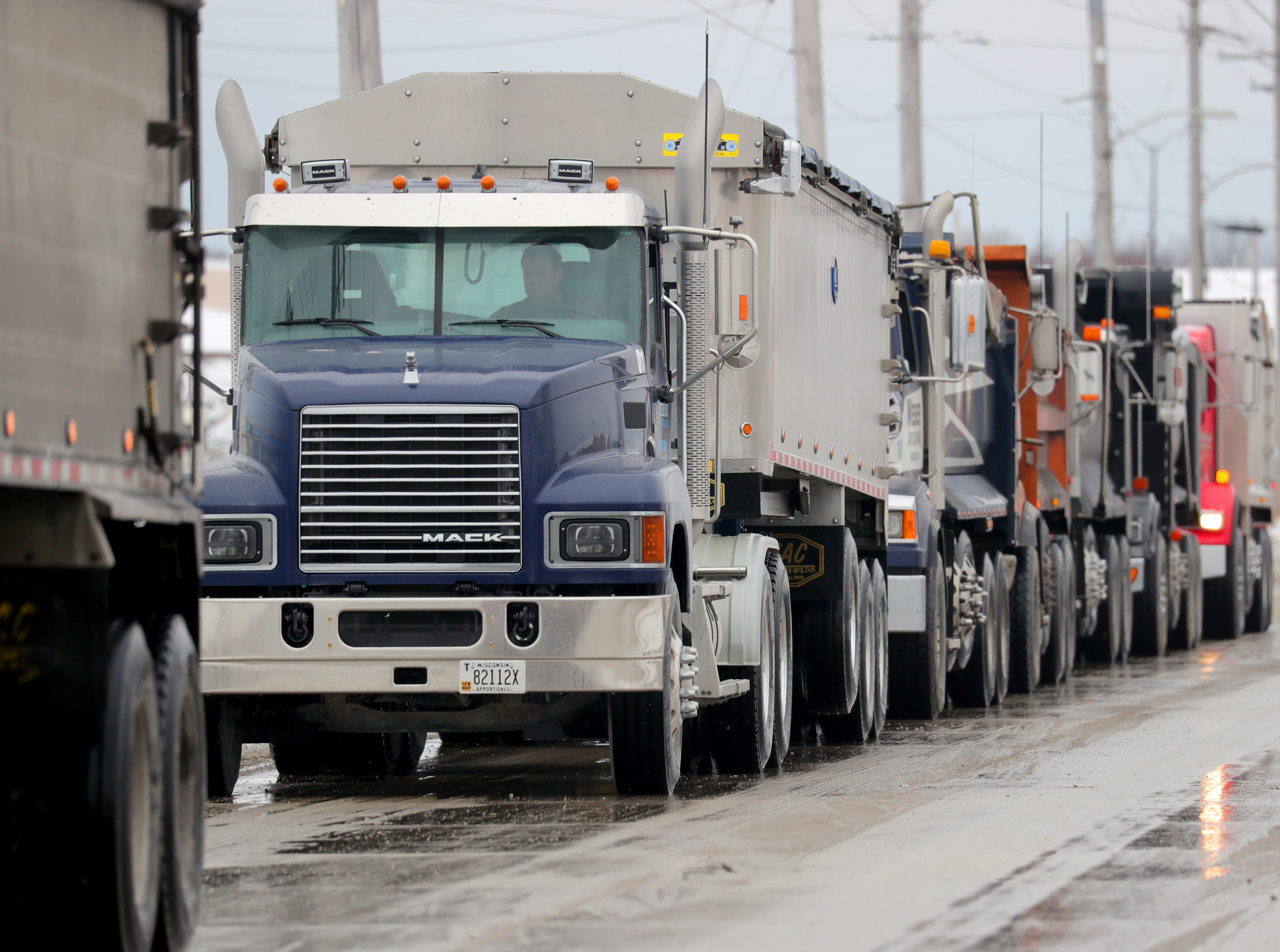 A row of truck line up to get salt at the Port of Milwaukee in Milwaukee on Monday, Feb. 11, 2019 as preparations are underway for snow removal and road treatment due to the upcoming snow in the forecast. The National Weather Service has issued a winter storm warning for central, northern and northeastern Wisconsin from 9 p.m. Monday until 12 a.m. Wednesday. Photo by Mike De Sisti / Milwaukee Journal Sentinel