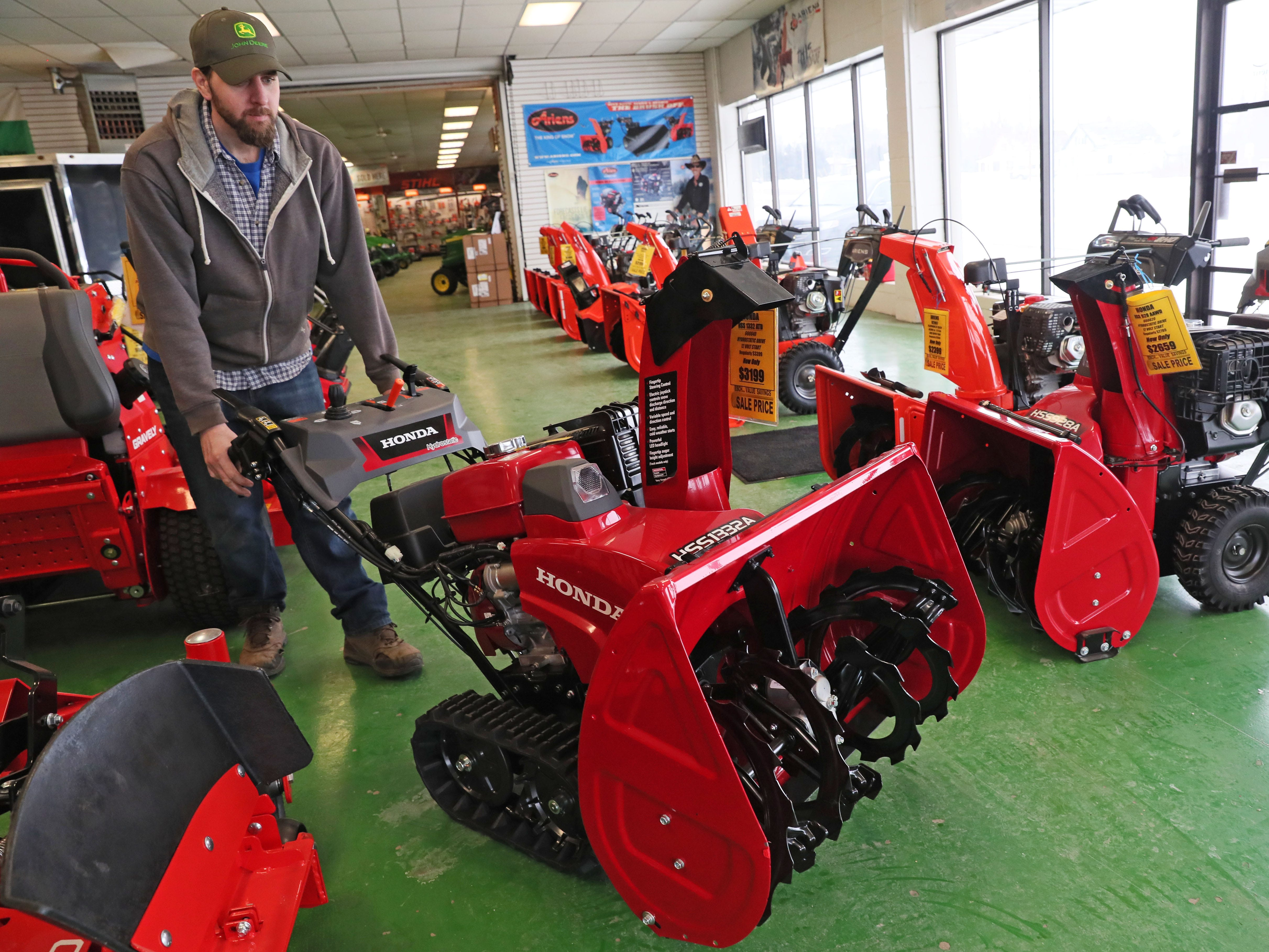 February 11, 2019 Adam Gliszinski at Esch Power Equipment in Oak Creek, moved a Honda two-stage track drive snow blower w/ 12-Volt Electric Start into the line of snowblowers for sale on the shop floor.