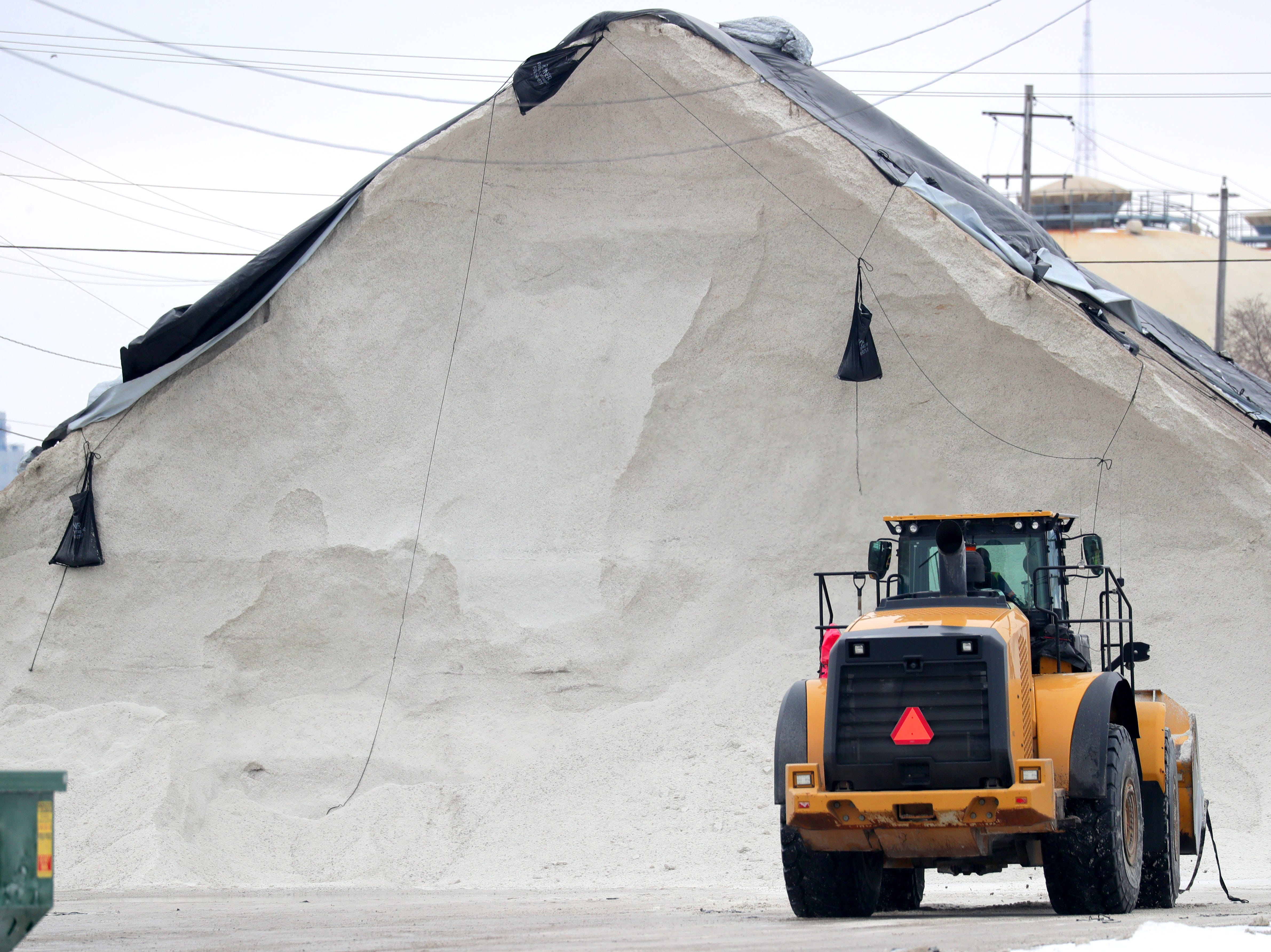 A front loader works near a salt pile at the Port of Milwaukee in Milwaukee on Monday, Feb. 11, 2019 as preparations are underway for snow removal and road treatment due to the upcoming snow in the forecast. The National Weather Service has issued a winter storm warning for central, northern and northeastern Wisconsin from 9 p.m. Monday until 12 a.m. Wednesday. Photo by Mike De Sisti / Milwaukee Journal Sentinel