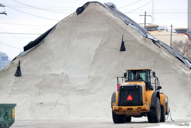Cudahy has awarded a bid allowing for the construction of a controversial salt storage facility. Here, a front loader works near a salt pile at the Port of Milwaukee in Milwaukee on Monday, Feb. 11, 2019.