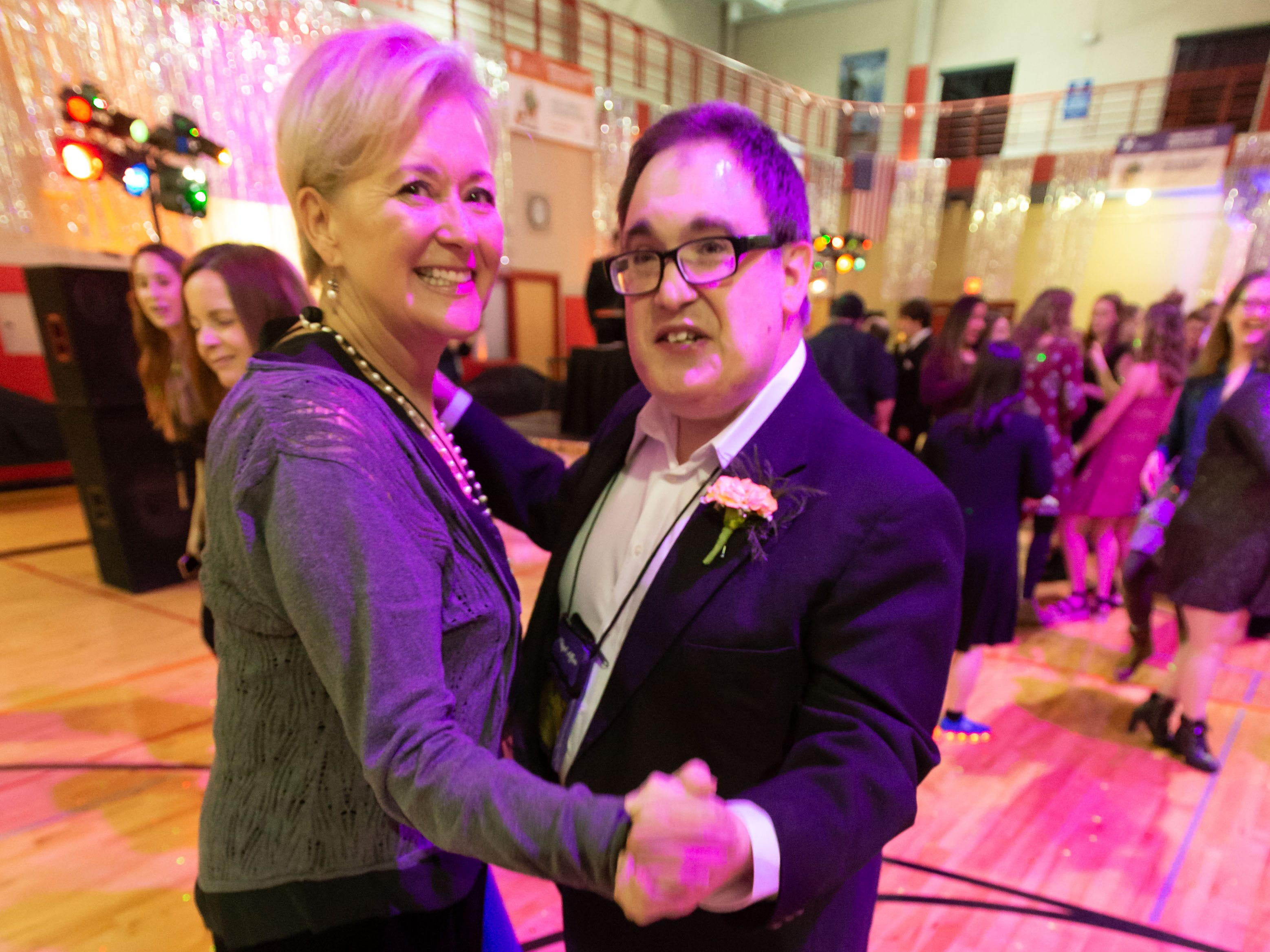 "Jeff B. and his chaperone Kirsten S. enjoy a dance during the ""A Royal Affair"" prom event hosted by Crosspoint Community Church and Pabst Farms YMCA in Oconomowoc on Friday, Feb. 8, 2019. A Royal Affair is a free, full-size prom event for people with any sort of special need, complete with limo rides, a red carpet reception, photo booths, dinner, dancing, karaoke, a balloon drop and more."