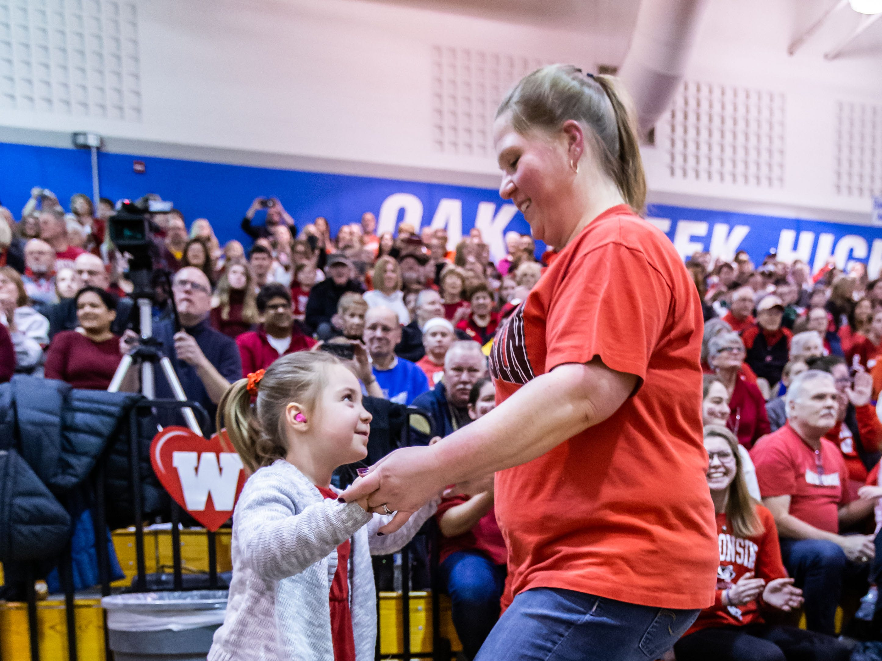 """Nicole Kielman of Milwaukee dances with her 5-year-old daughter Emily during the University of Wisconsin-Madison Varsity Band's 23rd """"Show and Revue"""" at the Oak Creek High School gymnasium on Sunday, Feb. 10, 2019."""