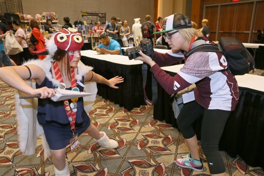 "Anime Milwaukee, back this weekend at the Wisconsin Center and the Hyatt Regency Milwaukee, is a place to see and be seen, especially dressed as your favorite fantasy character. At the 2016 event, Annalise Scaffidi of Hartland (left) was dressed as San from the Japanese animated classic ""Princess Mononoke."""