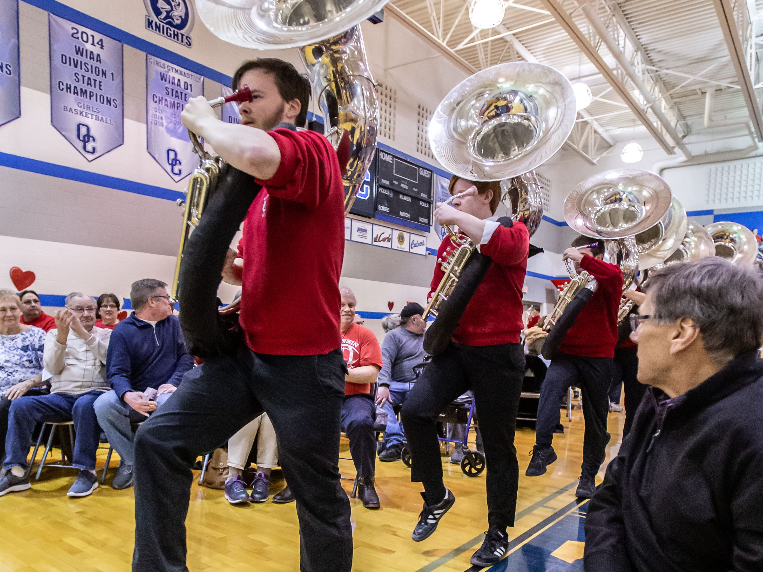 """Members of the University of Wisconsin-Madison Varsity Band high-step into the Oak Creek High School gymnasium for the band's 23rd """"Show and Revue"""" on Sunday, Feb. 10, 2019."""