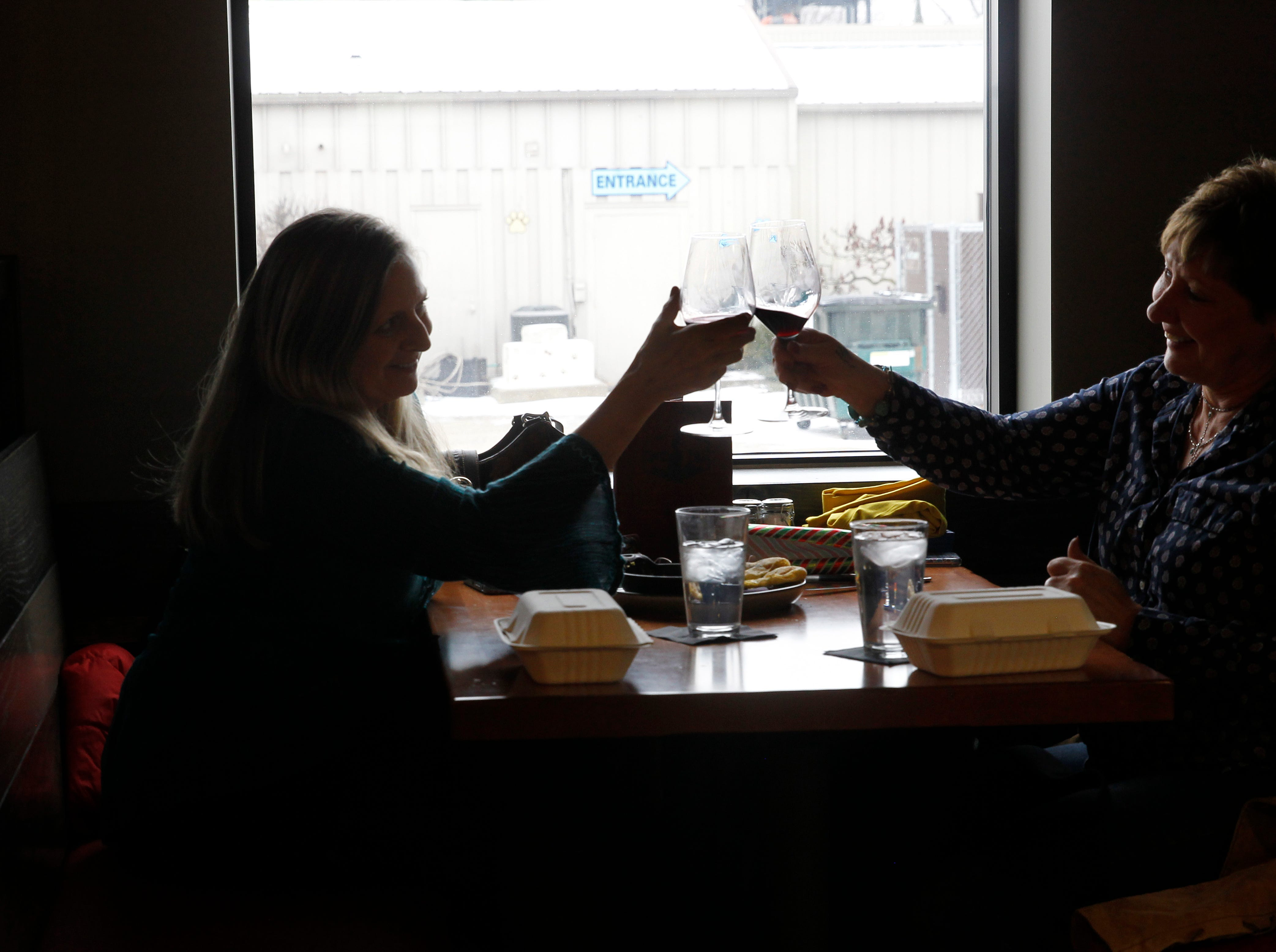 "Kathryn Franke, left and Lisa Guido, toast during lunch at the Twisted Fire restaurant at 515 E. Wisconsin Ave., Oconomowac, Wi., Wednesday, Feb. 6, 2019. ""I love the menu. It is super flavorful and healthy. Does not disappoint, "" Franke said. This was her first time dining at the restaurant."