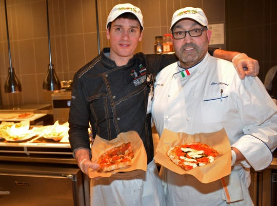 Calderone Club chef Robin Brown and restaurant owner Gino Fazzari at the restaurant-themed stand at Fiserv Forum. The stand opened earlier this month.