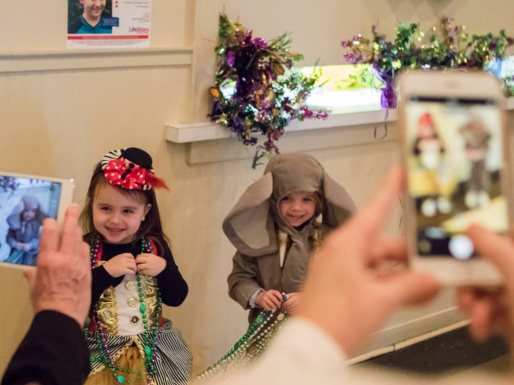 Parents snap pictures of their kids during St. Paul's Day School annual Krewe of Munchkins Parade in Monroe, La. on Feb. 11.