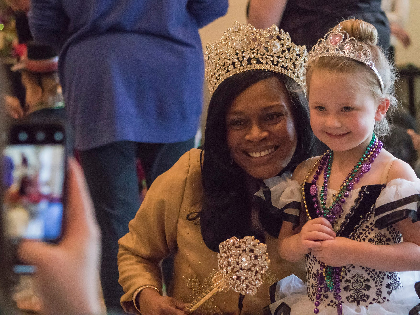 Blanche Betz, the Krewe of Janus Mardi Gras queen, and Charlie Prichard, 3, pose for a photo during the Krewe of Munchkins parade at St. Paul's Day School in Monroe, La. on Feb. 11.