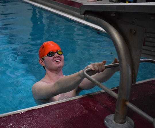 Ryan May, a Morristown High School swimmer who has autism, prepares to start the backstroke at the Kids2Kids meet on Saturday.
