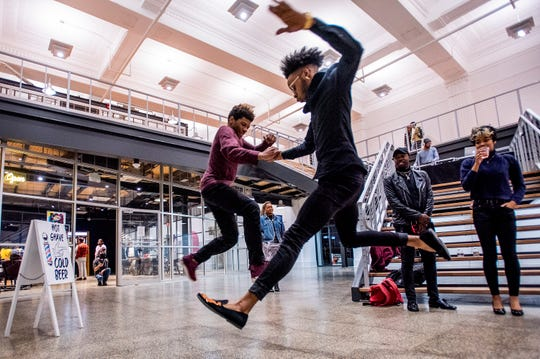 Dancers perform during the opening of the fe(male) art exhibit at the Kress Building on Dexter Avenue in downtown Montgomery, Ala., on Saturday February 9, 2019.