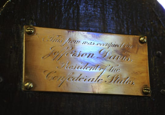 A plaque marking the pew that was occupied by President of the Confederacy Jefferson Davis and his family in St. John's Episcopal Church in downtown Montgomery, Ala.
