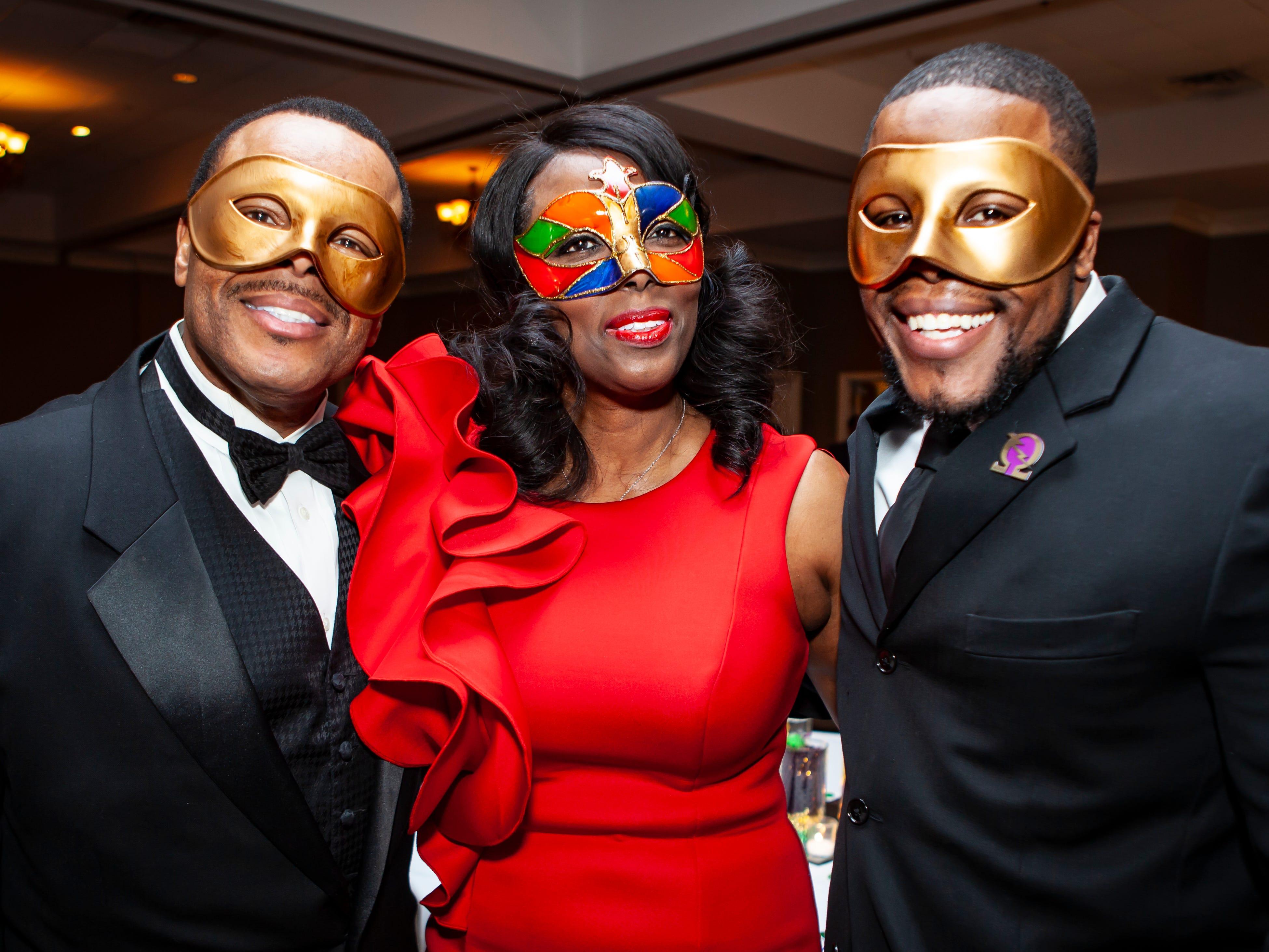 Carlos, Shenita and DeCarlos Baker at the Omega Psi Phi Mardi Gras party held Saturday, Feb. 9, 2018 at Stones River Country Club in Murfreesboro.