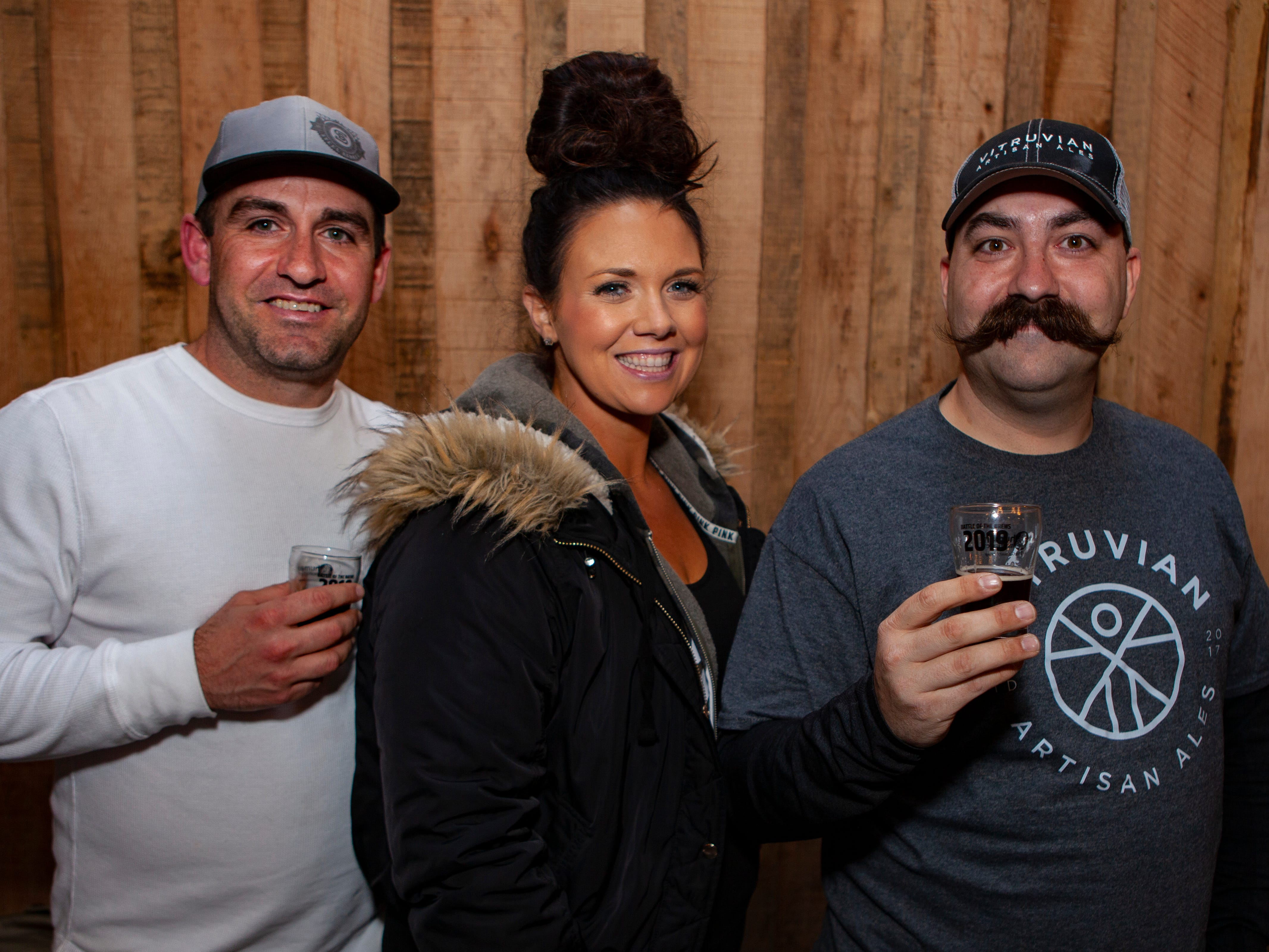 Adam and Kaylee Foret with Joshua Jackson at the third annual Battle of the Brews, a benefit for Kymari House Inc., held Saturday, Feb. 9, 2019 at The Grove at Williamson Place in Murfreesboro.