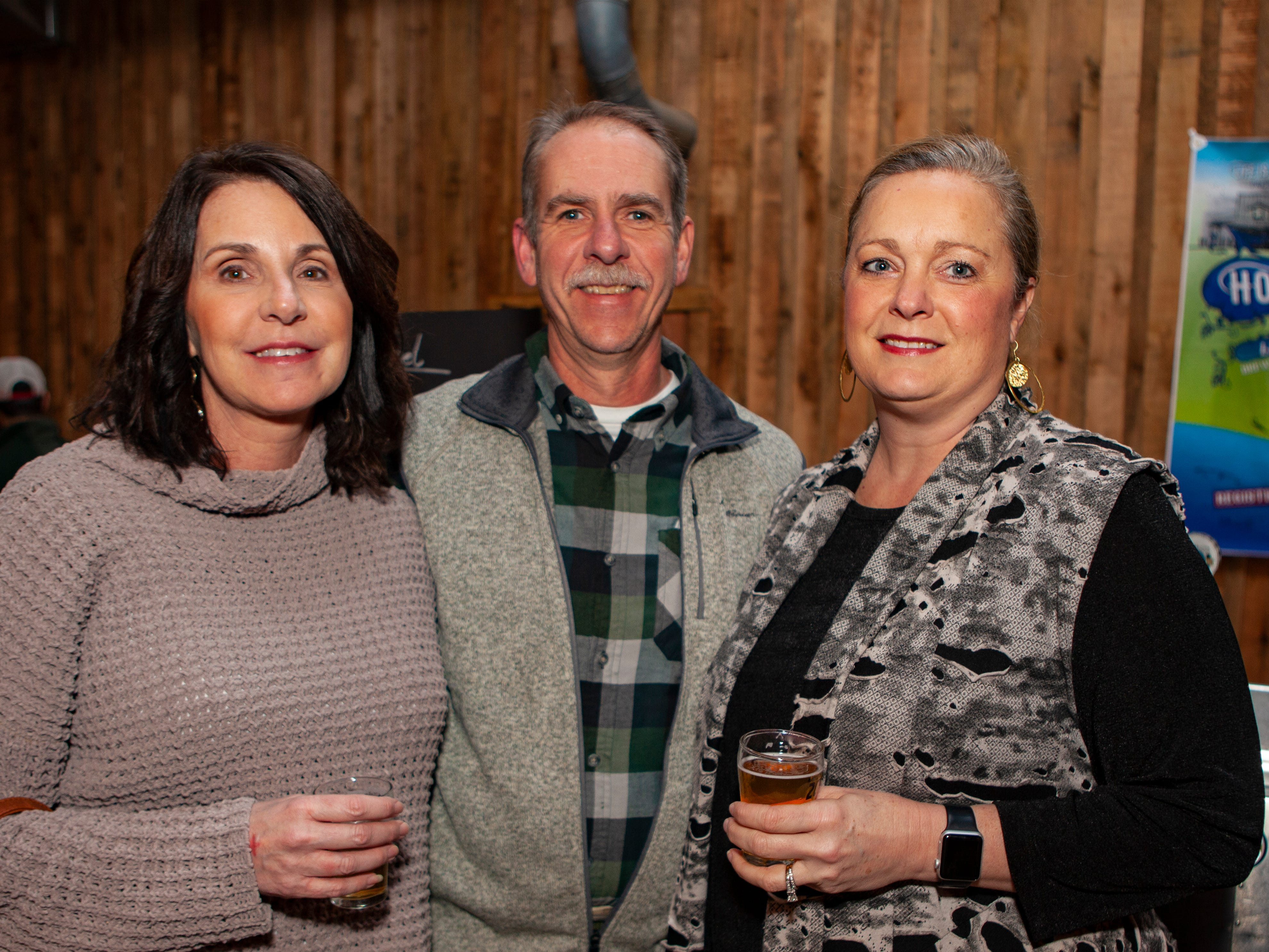 Lisa and Gary Wilson with Denise Flanagan at the third annual Battle of the Brews, a benefit for Kymari House Inc., held Saturday, Feb. 9, 2019 at The Grove at Williamson Place in Murfreesboro.