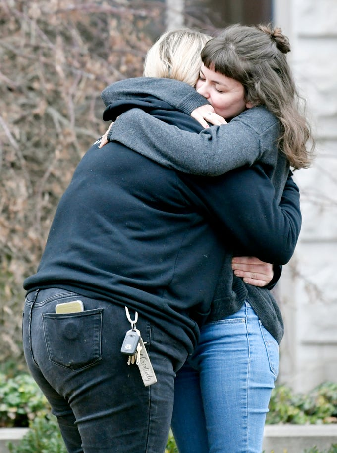 People hug outside the Belmont University Chapel at the Janet Ayers Academic Center, where the memorial service for Kyle Yorlets was held Monday, Feb. 11, 2019. Police have charged five juveniles in the case. The memorial service followed a press conference by his fellow Carverton band members.