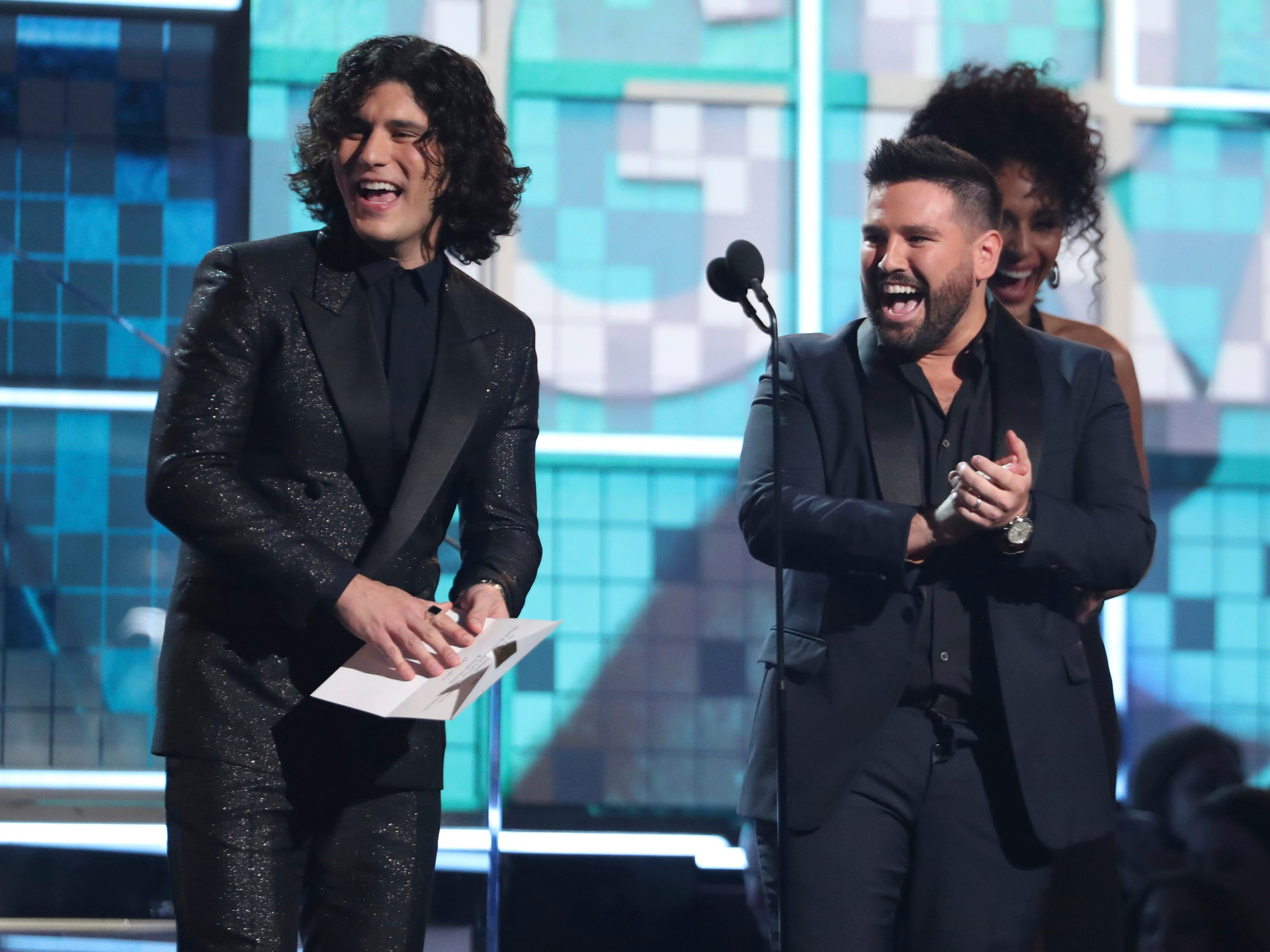 Dan Smyers, left, and Shay Mooney, of Dan + Shay, present the award for best rap song at the 61st annual Grammy Awards on Sunday, Feb. 10, 2019, in Los Angeles.