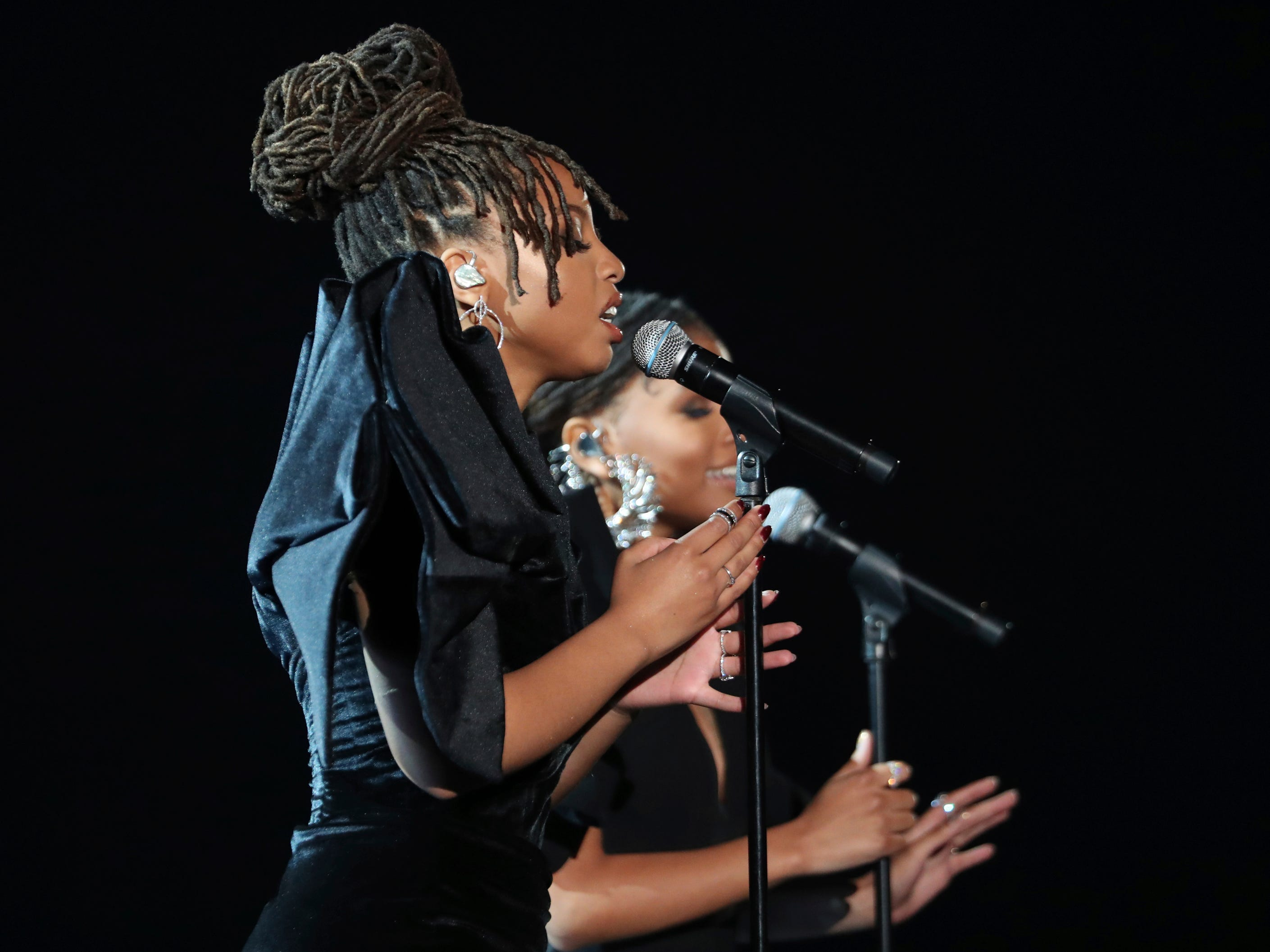 "Halle Bailey, foreground, and Chloe Bailey, of Chloe x Halle, perform ""Where Is The Love"" at the 61st annual Grammy Awards on Sunday, Feb. 10, 2019, in Los Angeles."