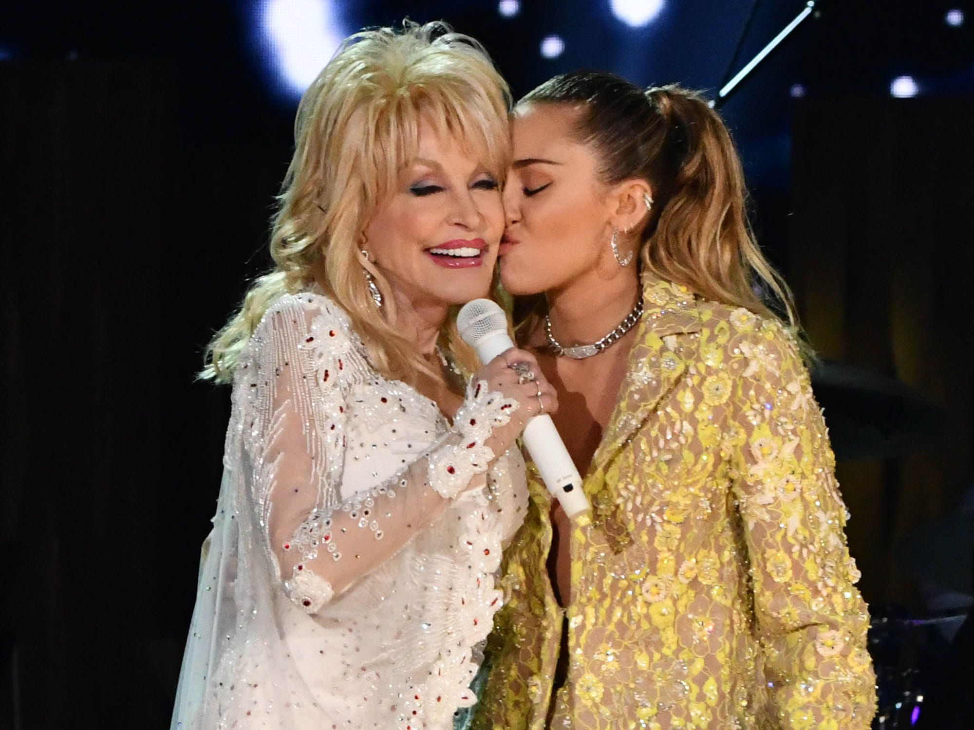 Miley Cyrus kisses Dolly Parton during a tribute to Dolly Parton at the 61st Annual GRAMMY Awards on Feb. 10, 2019 at STAPLES Center in Los Angeles, Calif.