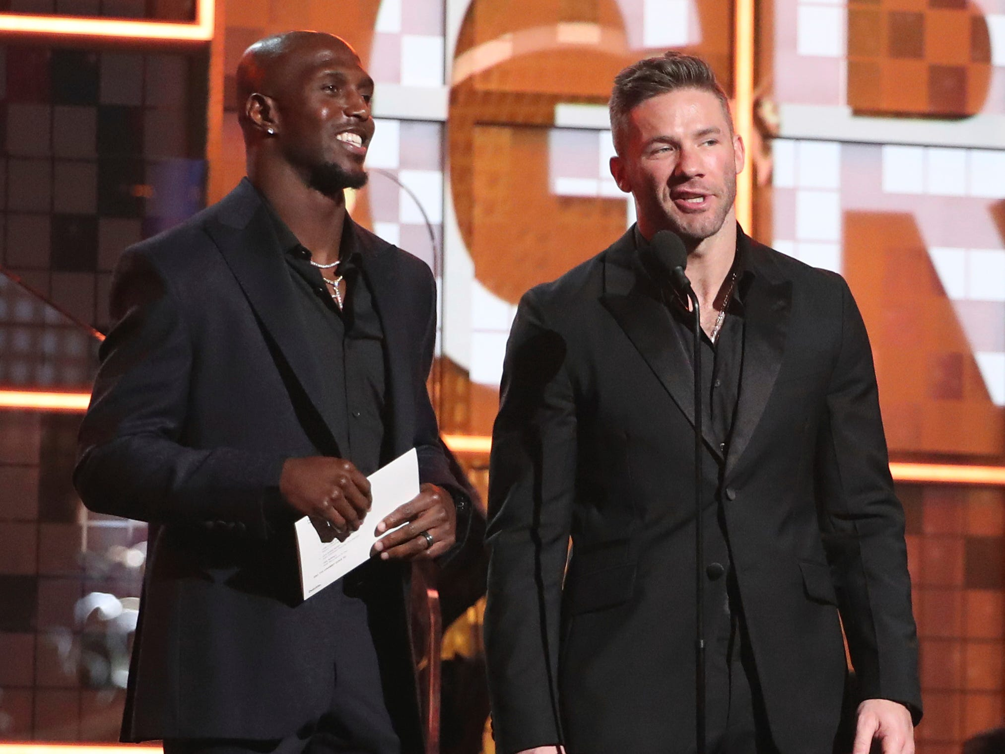 Devin McCourty, left, and Julian Edelman present the award for best pop duo or group performance at the 61st annual Grammy Awards on Sunday, Feb. 10, 2019, in Los Angeles.