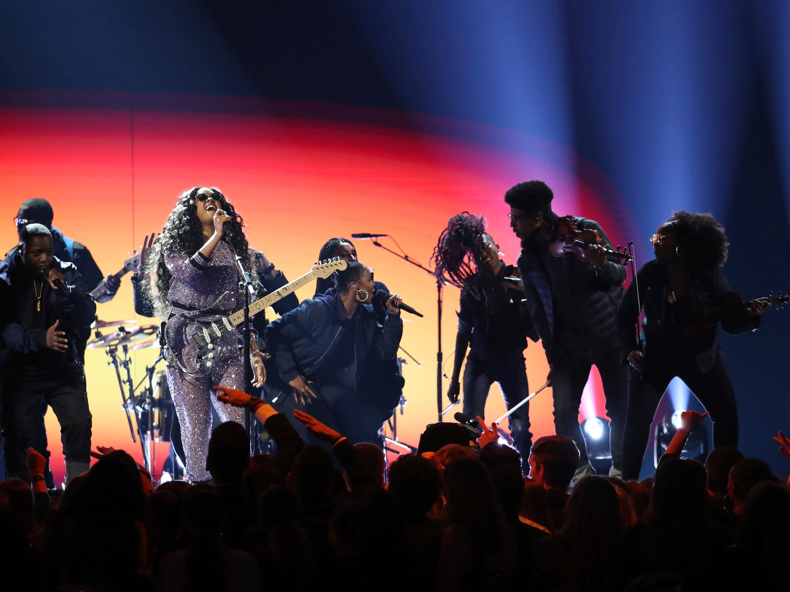 "H.E.R. performs ""Hard Place"" at the 61st annual Grammy Awards on Sunday, Feb. 10, 2019, in Los Angeles."