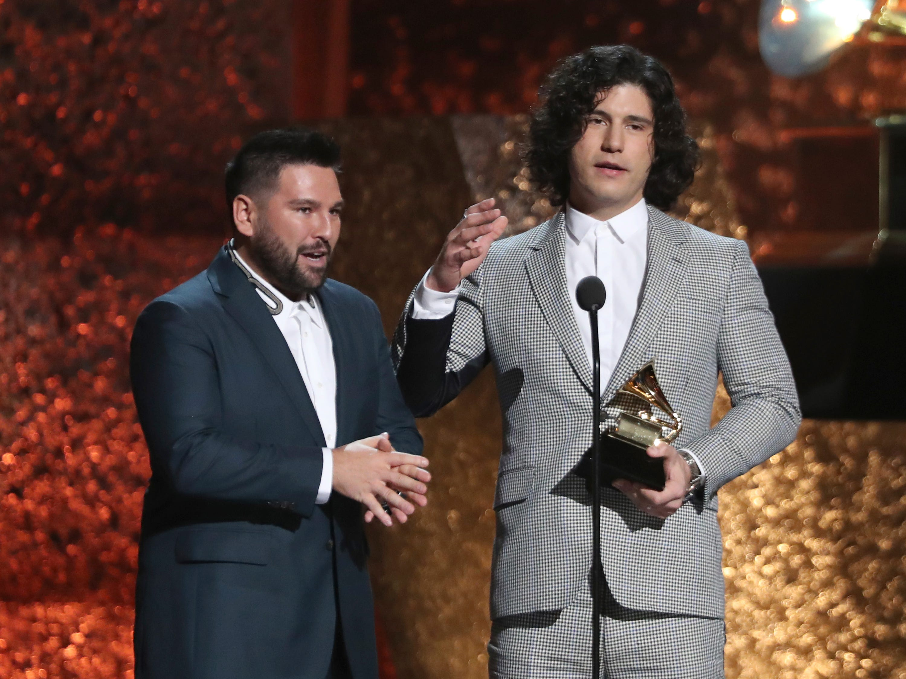 "Shay Mooney, left, and Dan Smyers of ""Dan + Shay"" accept the award for best country duo/group performance for ""Tequila"" at the 61st annual Grammy Awards on Sunday, Feb. 10, 2019, in Los Angeles."