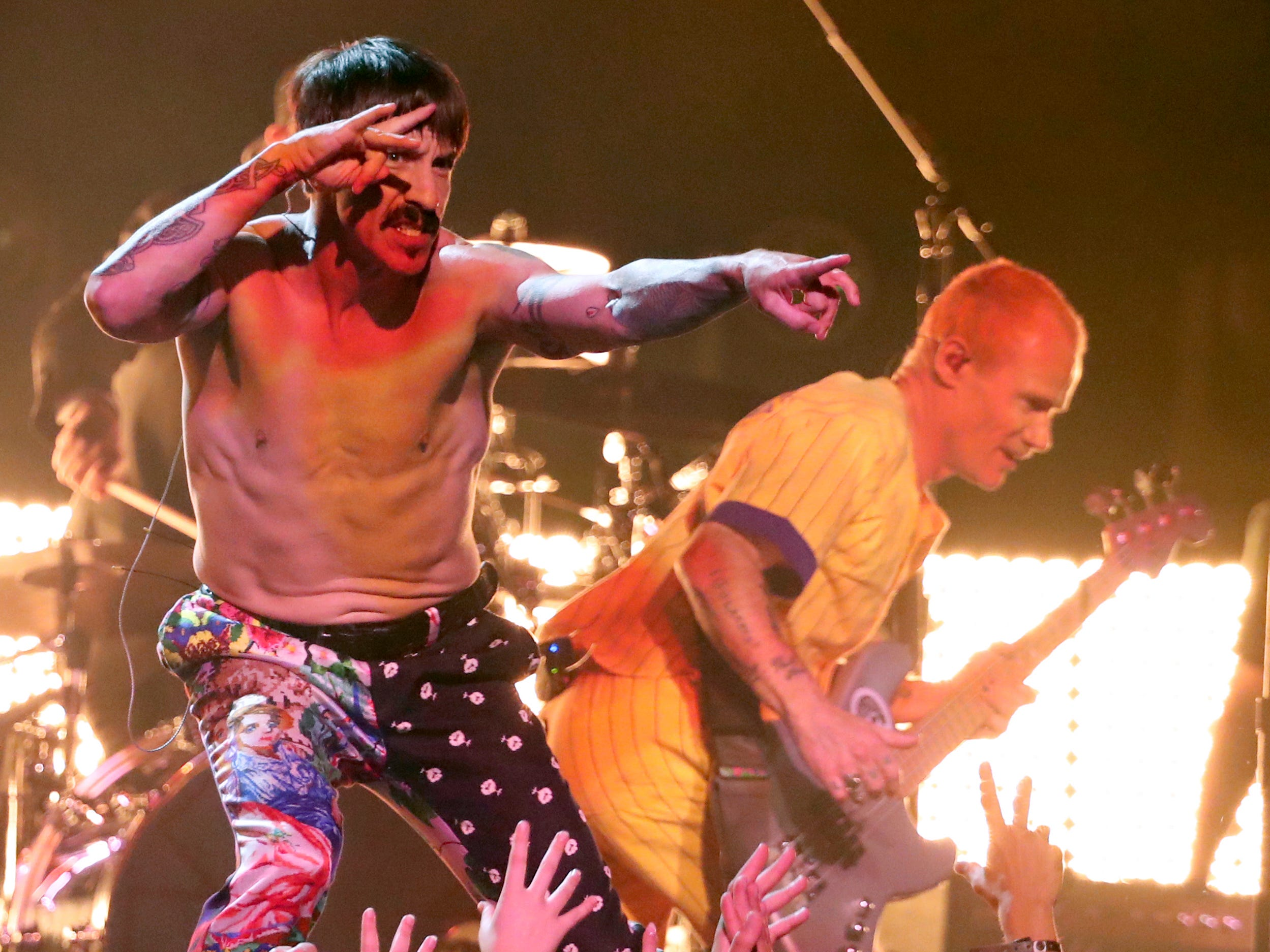 Anthony Kiedis, left, and Flea, of Red Hot Chili Peppers, perform a medley at the 61st annual Grammy Awards on Sunday, Feb. 10, 2019, in Los Angeles.