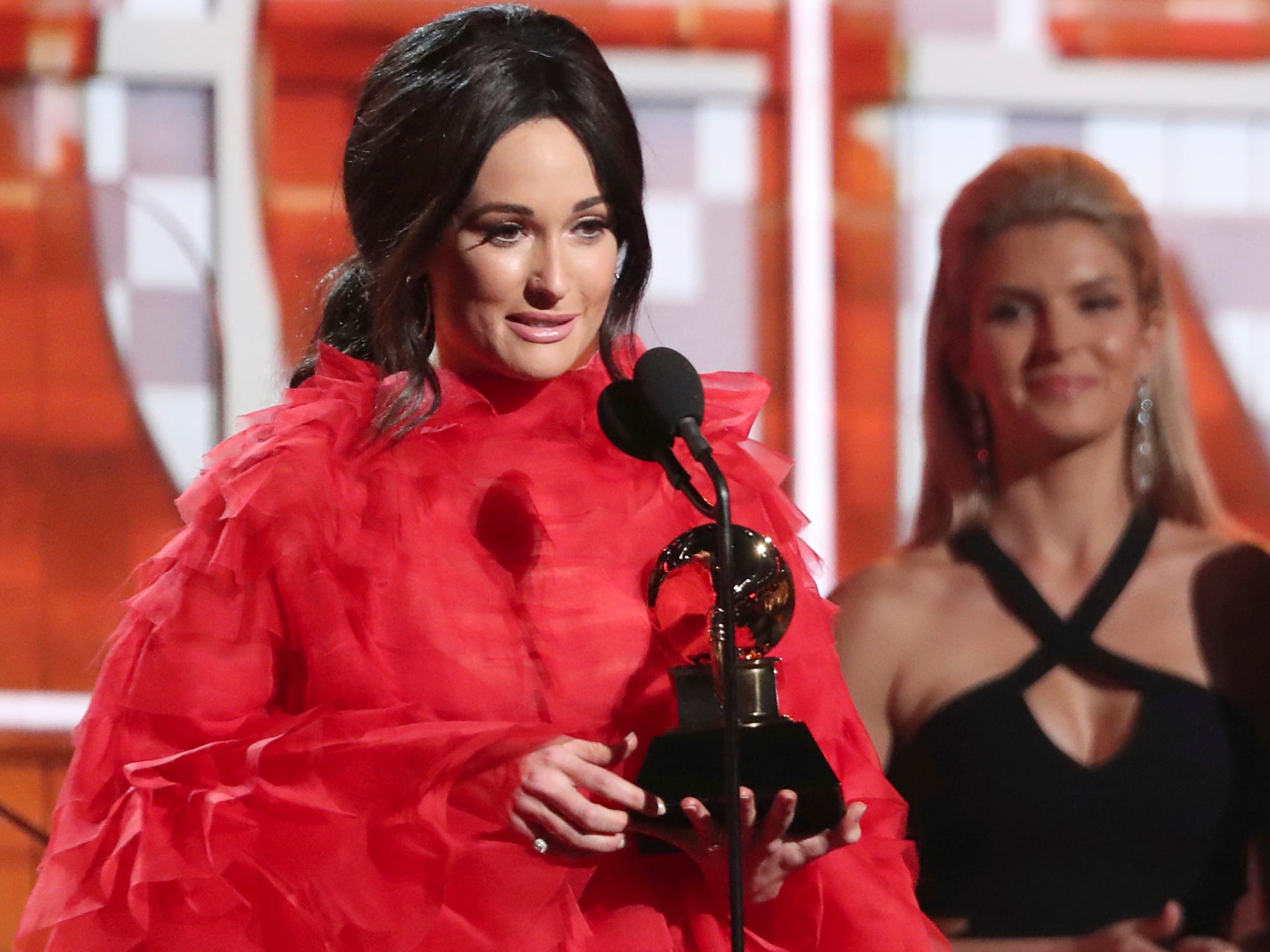 "Kacey Musgraves accepts the award for best country album for ""Golden Hour"" at the 61st annual Grammy Awards on Sunday, Feb. 10, 2019, in Los Angeles."