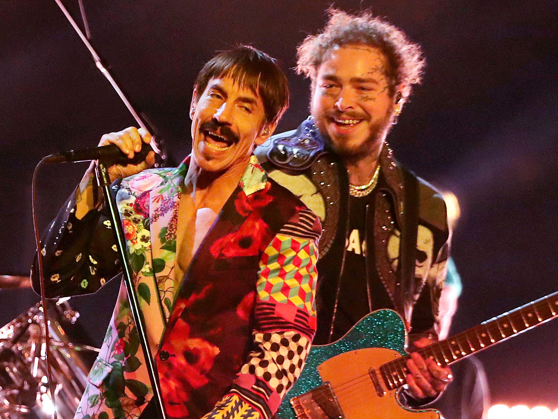 Anthony Kiedis, left, of Red Hot Chili Peppers, and Post Malone perform a medley at the 61st annual Grammy Awards on Sunday, Feb. 10, 2019, in Los Angeles.